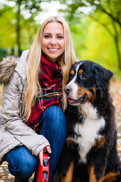 Woman cuddling with Bernese mountain dog Stock photo © Kzenon