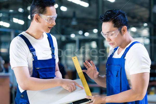 Carpenter team in Asian wood workshop  Stock photo © Kzenon
