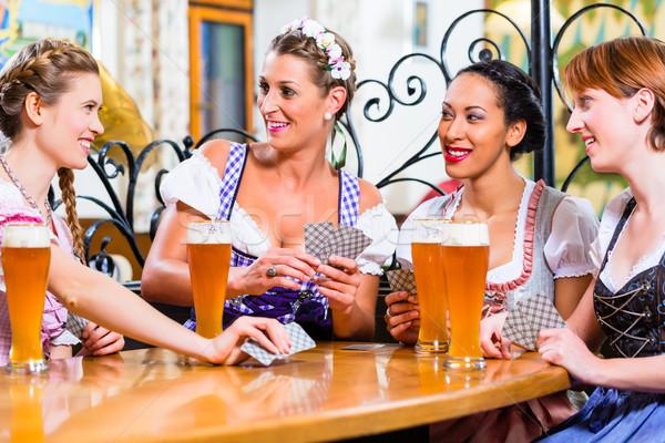 Women in Bavarian pub playing cards Stock photo © Kzenon