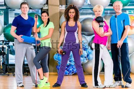 Piękna kobiet uruchomiony miejscu treningu klasy Zdjęcia stock © Kzenon