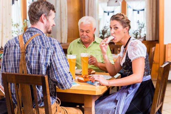 Man and woman eating in bavarian restaurant Stock photo © Kzenon