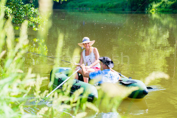 Couple in boat on pond or lake fishing  Stock photo © Kzenon