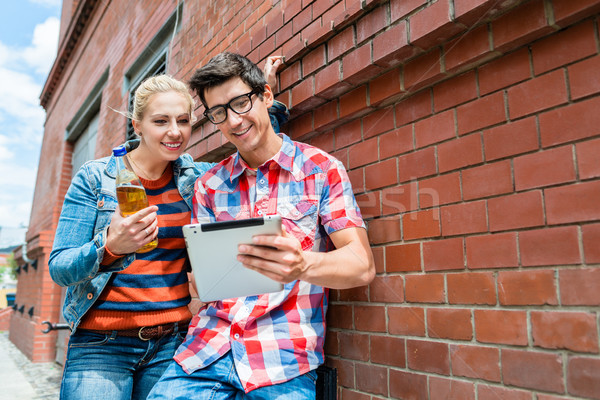 Couple on holidays organizing sightseeing tour with tablet PC Stock photo © Kzenon