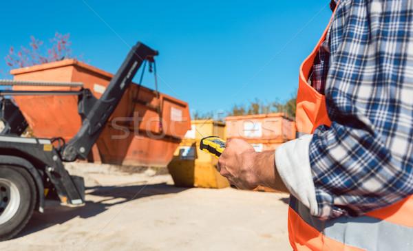Man loading of construction debris container on truck Stock photo © Kzenon