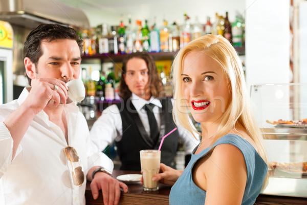 Attractive couple in cafe or coffeeshop Stock photo © Kzenon