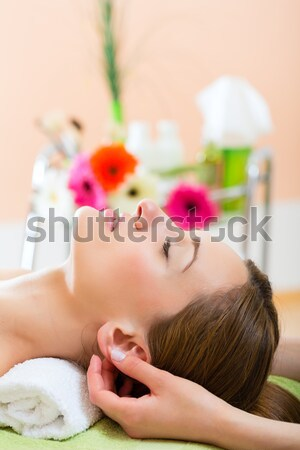 Woman enjoying head massage in a spa Stock photo © Kzenon