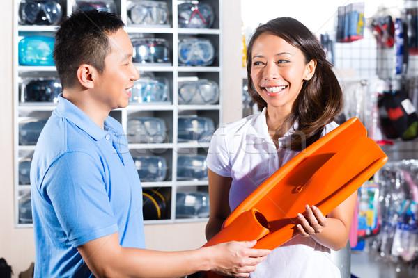 Customer buying equipment in divers shop Stock photo © Kzenon