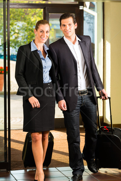 Business people arriving at Hotel Stock photo © Kzenon