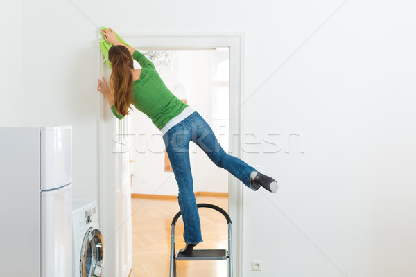 Woman at the spring cleaning working dangerously Stock photo © Kzenon
