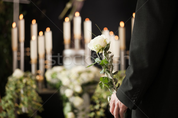Religion, death and dolor  - man at funeral with white rose mourning the dead Stock photo © Kzenon