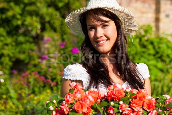 Gardening in summer - woman with flowers Stock photo © Kzenon