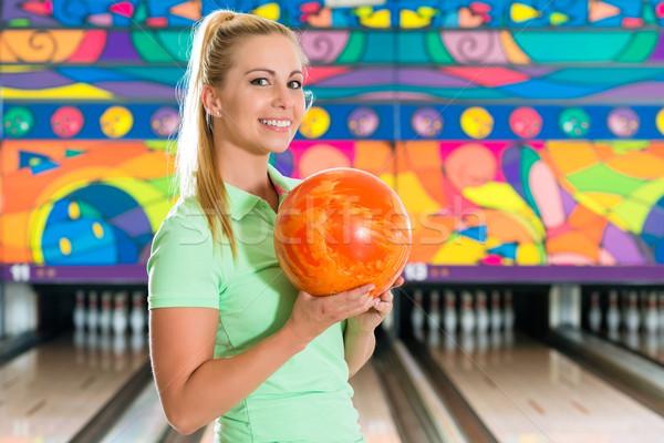 Young woman bowling having fun Stock photo © Kzenon