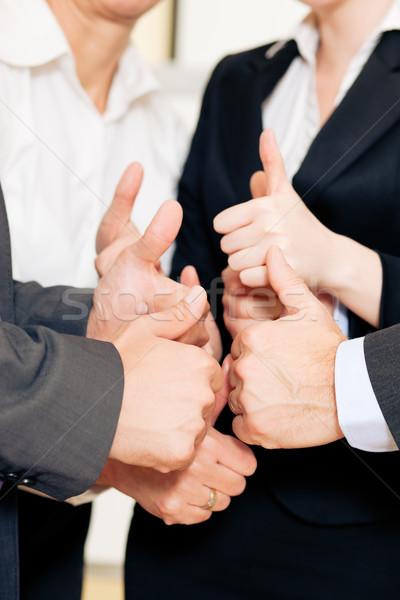 Business team thumbs up Stock photo © Kzenon