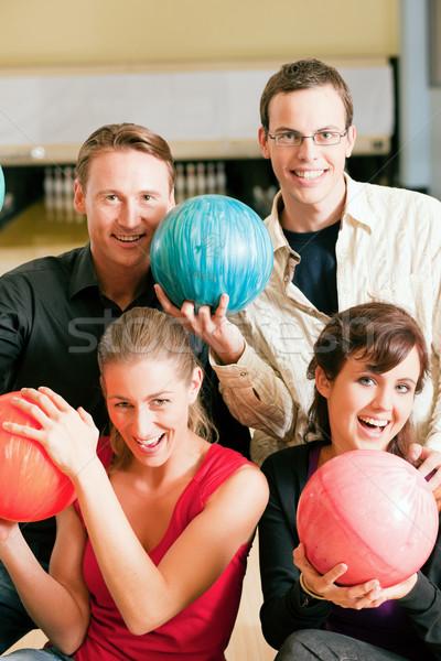 Friends bowling together Stock photo © Kzenon