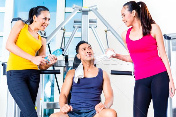 Women teasing man at gym Stock photo © Kzenon
