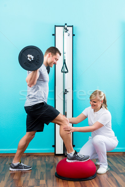 Physiotherapist or sport doctor with patient stock photo © Arne ...
