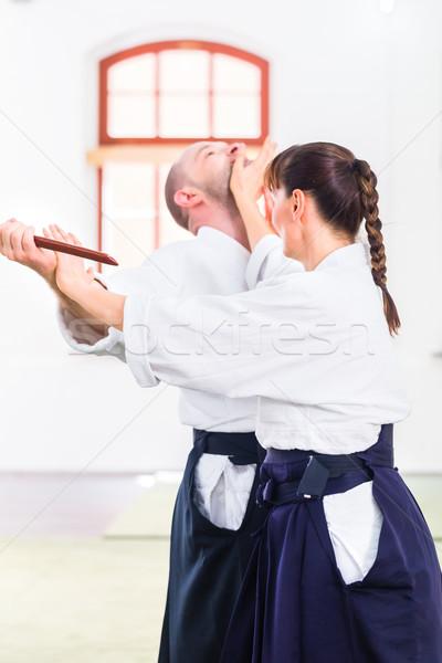 Man vrouw aikido mes strijd vechten Stockfoto © Kzenon