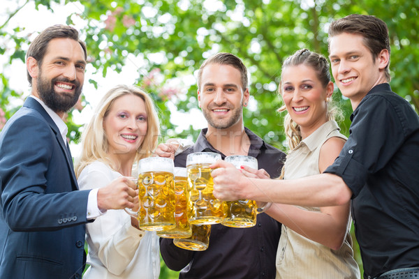 Co-Workers after work drinking beer together Stock photo © Kzenon
