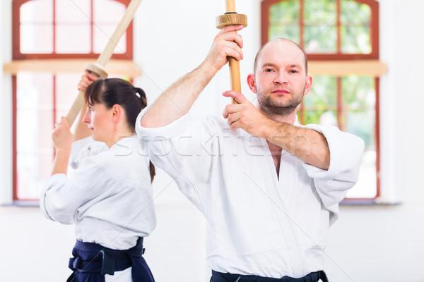 Man vrouw aikido zwaard strijd vechten Stockfoto © Kzenon