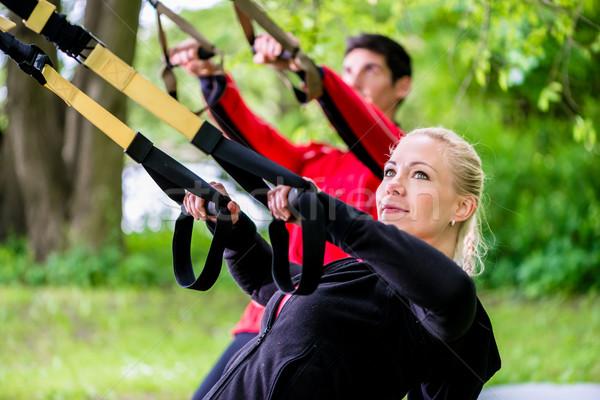 Sportos pár csúzli edző fitnessz nő Stock fotó © Kzenon