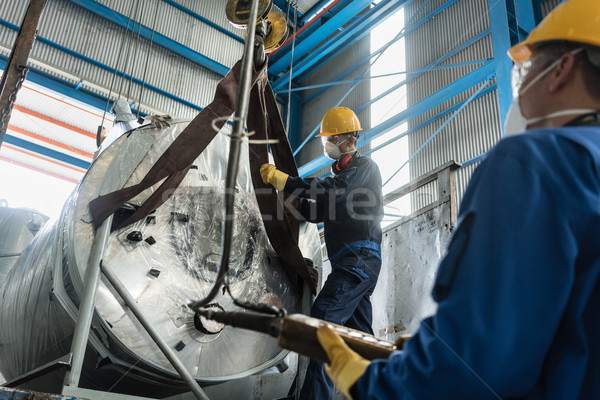Workers handling equipment for lifting industrial boilers Stock photo © Kzenon