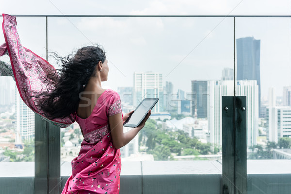 Jovem indiano mulher terraço ventoso Foto stock © Kzenon