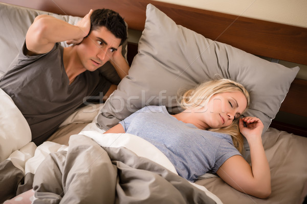 Man annoyed by the snoring of his partner Stock photo © Kzenon
