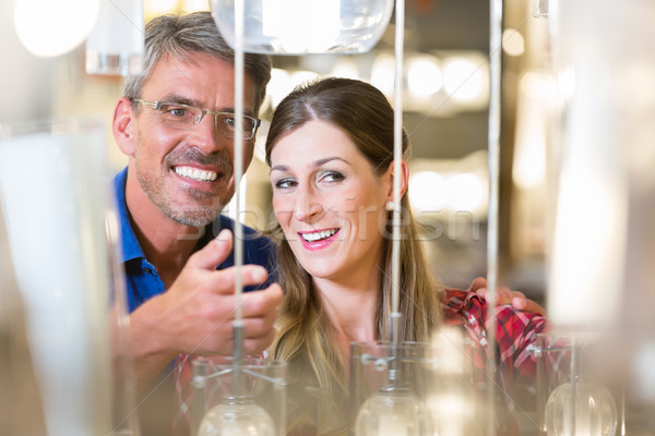 Couple in hardware store looking for lamps Stock photo © Kzenon