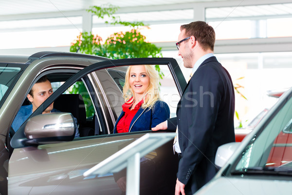 Couple buying new car at dealership Stock photo © Kzenon