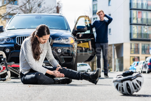 Bicyclist with serious injuries after traffic accident Stock photo © Kzenon