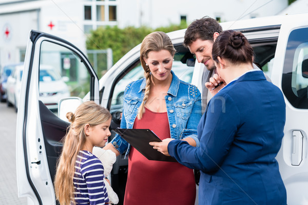 Family being advised by salesperson buying car Stock photo © Kzenon