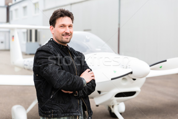 Sport pilot in front of his plane Stock photo © Kzenon