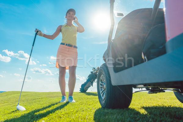 Tam uzunlukta aktif kadın konuşma cep telefonu golf sahası Stok fotoğraf © Kzenon
