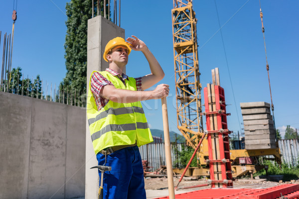 Young blue-collar worker looking up with a worried facial expression Stock photo © Kzenon