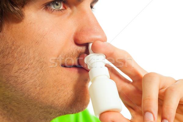 Young man with nasal spray Stock photo © Kzenon