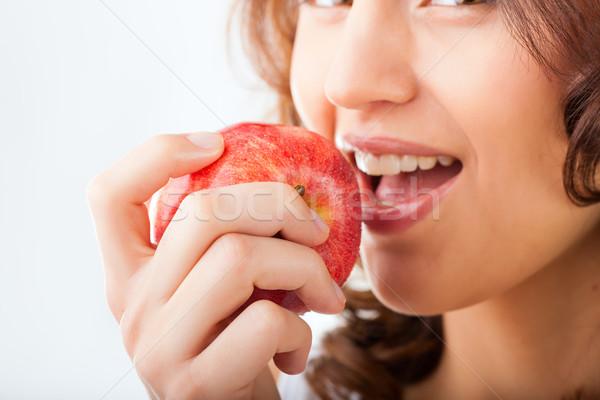 Young woman bites in a apple Stock photo © Kzenon