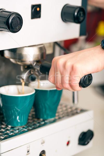 Coffeeshop - barista presents coffee Stock photo © Kzenon