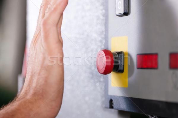 Emergency - Man shutting machine of Stock photo © Kzenon
