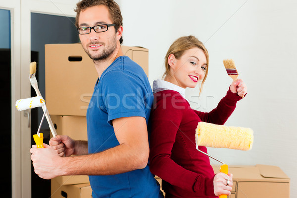 Young couple moving in new home Stock photo © Kzenon