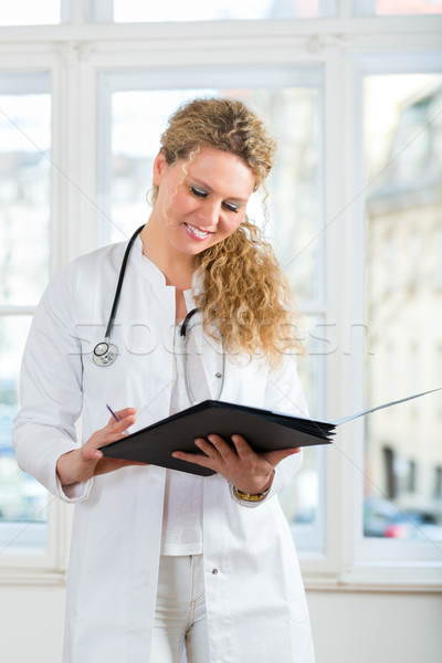 doctor with test result in document or dossier Stock photo © Kzenon