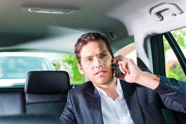 Hombre taxi nombramiento jóvenes empresario Foto stock © Kzenon