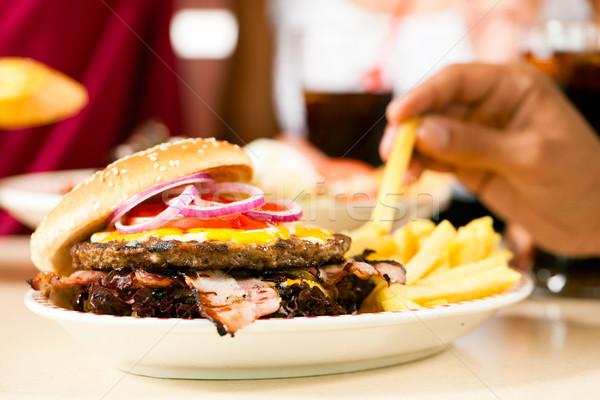 Hamburger in a restaurant Stock photo © Kzenon