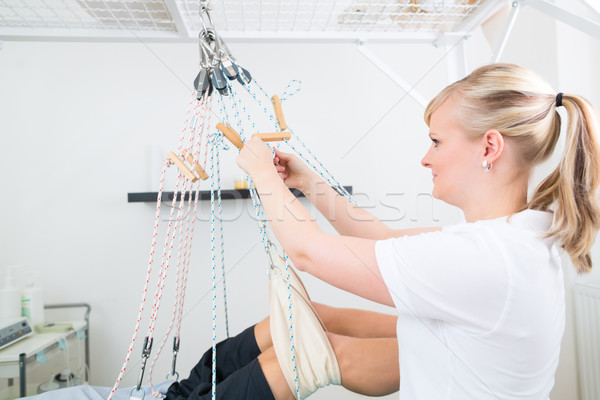 Physiotherapist with patient on sling table   Stock photo © Kzenon