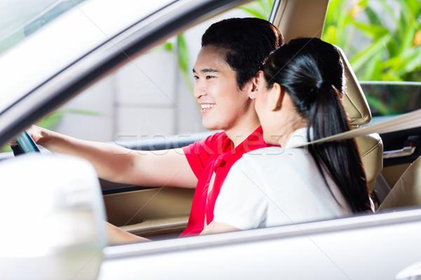 Asian couple driving new car Stock photo © Kzenon