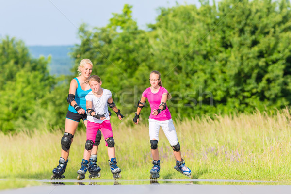 Stock photo: Family rollerblade with skates on country lane