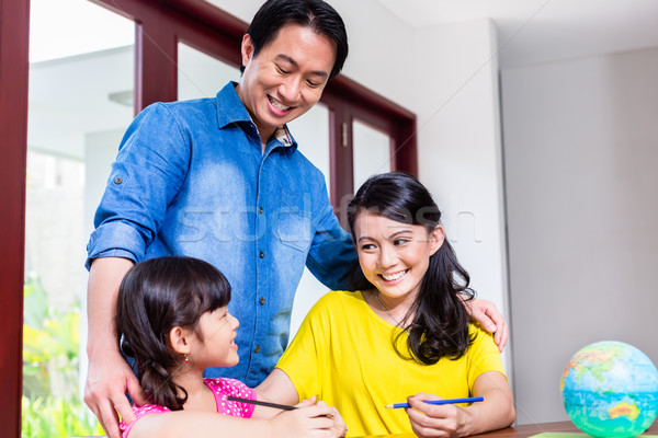 Chinese family learning mathematics with her child Stock photo © Kzenon