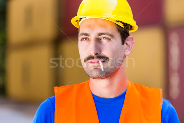 Smoking worker in logistics company with cigarette  Stock photo © Kzenon