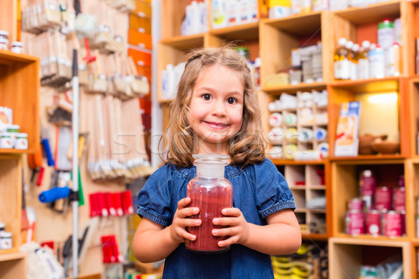 Child with color or paint pigments in store Stock photo © Kzenon