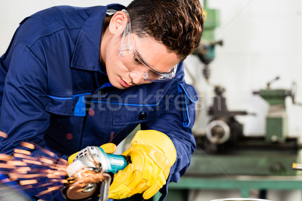 Asian worker grinding metal in manufacturing plant Stock photo © Kzenon