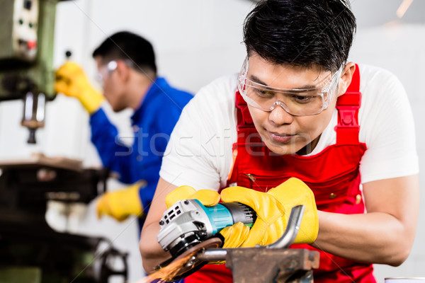Two industrial workers in Asian metal factory Stock photo © Kzenon